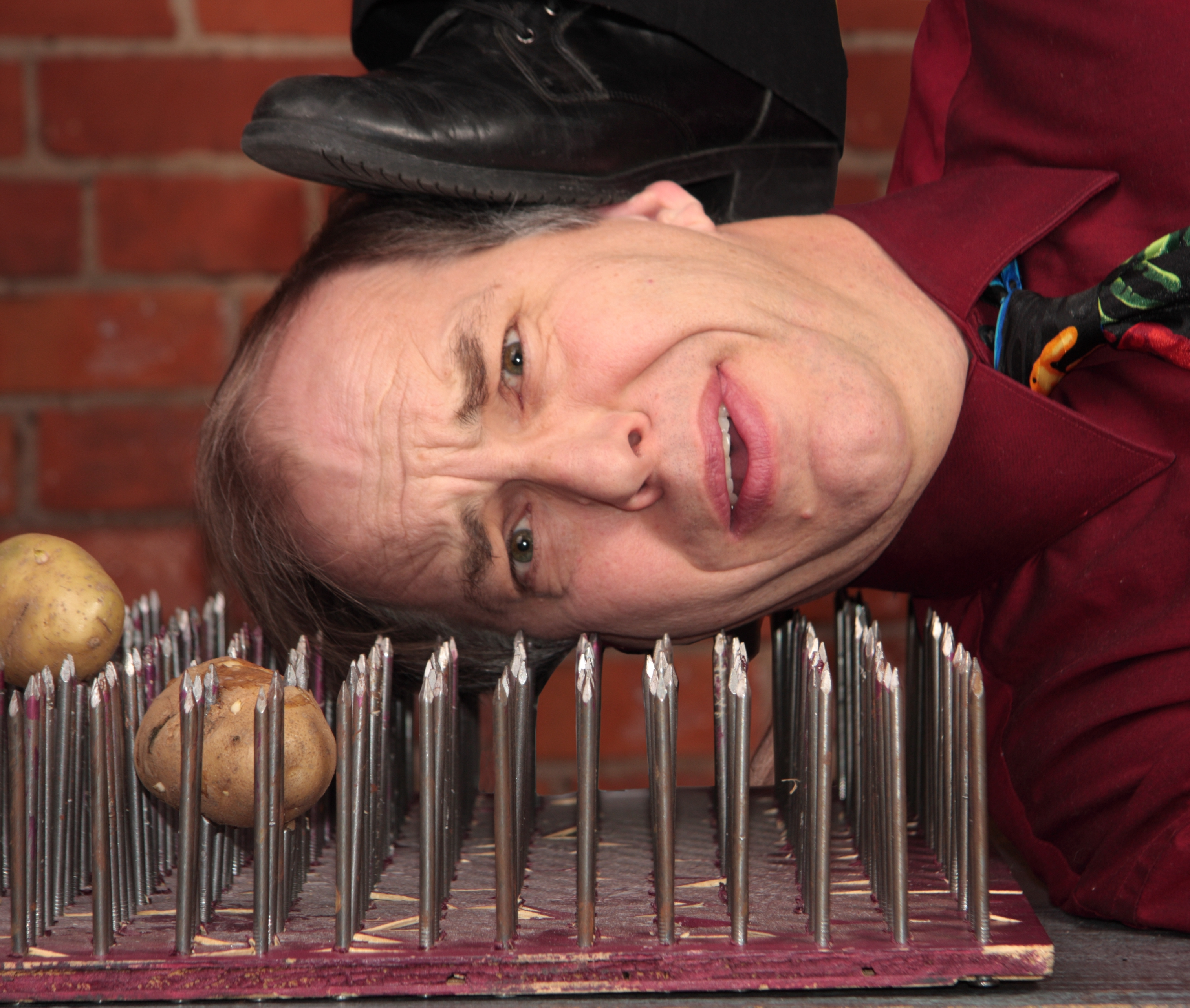Steve Russell Comic Juggler on a Bed of Nails